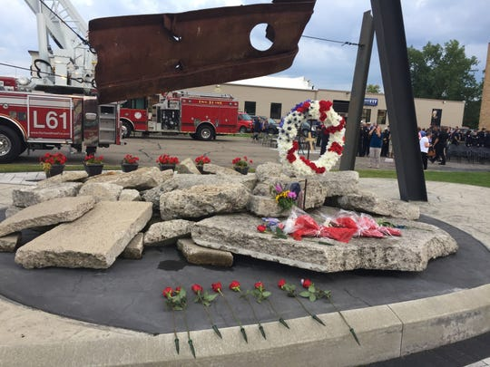A twisted piece of steel from one of the twin towers serves as a memorial to lives lost in the Sept. 11, 2001 attacks in front of Brighton Area Fire Authority's Station 31, shown Wednesday, Sept. 11, 2019.