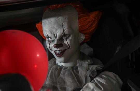 """Pennywise sits behind the wheel of Andrew Johnson's """"It"""" themed Jeep."""