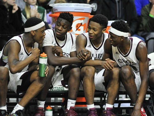 Cassius Winston, far left, and Elijah Collins, third from left, shared the same 28-0 state champion basketball team at University of Detroit Jesuit High School in 2016-2017.