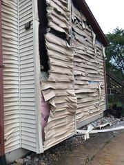 A home adjacent to the one that exploded sustained damage as shown on Sept. 12, 2019.