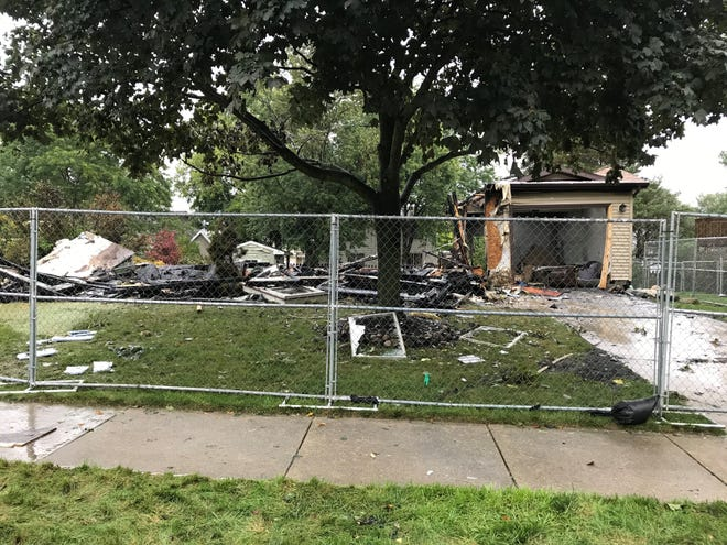 The remains of a home in the 1500 block of Jacqueline Drive in Delhi Township on Thursday, Sept. 12, 2019.