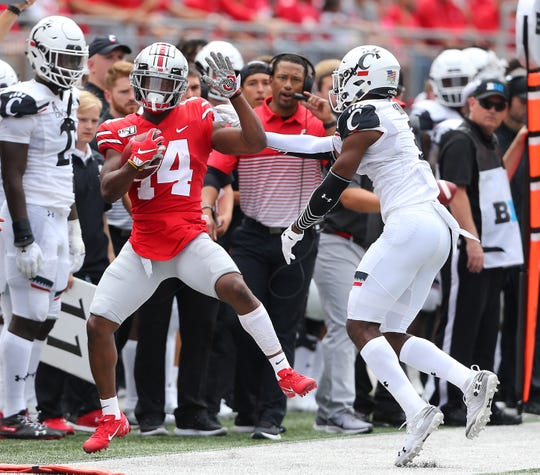"Ohio State H-back K.J. Hill, making a catch last week against Cincinnati, says road debacles the last two years at Iowa and Purdue are ""unexplainable"" and doesn't expect that to be an issue when the Buckeyes play their first road game of 2019 on Saturday at Indiana."