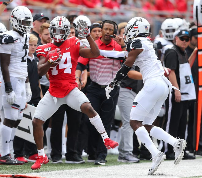 """Ohio State H-back K.J. Hill, making a catch last week against Cincinnati, says road debacles the last two years at Iowa and Purdue are """"unexplainable"""" and doesn't expect that to be an issue when the Buckeyes play their first road game of 2019 on Saturday at Indiana."""