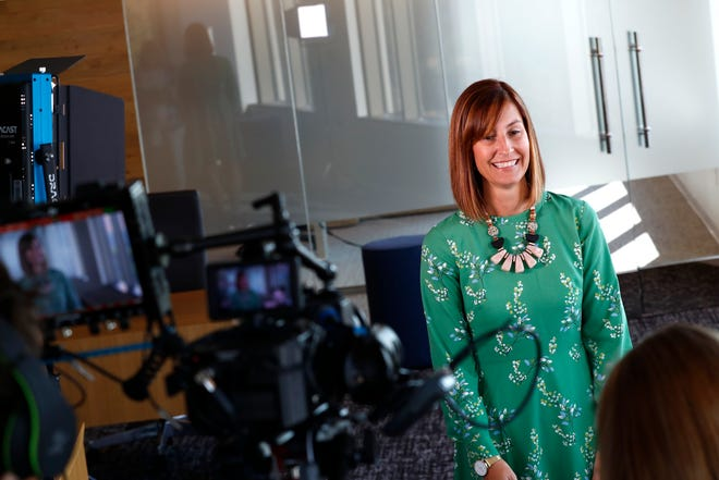 """Elisa Stratton, executive director of human resources for the Germantown Municipal School District, speaks with a film crew from """"Information Matrix,"""" a documentary program on PBS, at the TraVure building in Germantown on Thursday, Sept. 12, 2019."""