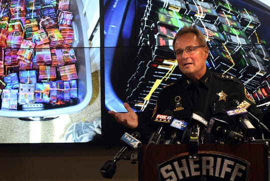 Kenosha County Sheriff David Beth talks about the THC-infused vaping cartridges that were part of a large-scale marijuana operation during a news conference in Kenosha Wednesday, Sept. 11, 2019.