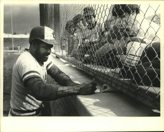Larry Hisle signs autographs for fans in 1981.