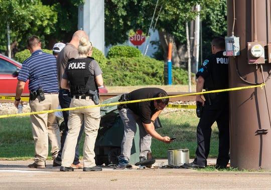 Monroe police investigate a device behind Cloyd's Beauty Schools on Ferrand Street to on Sept. 12 in Monroe, La.