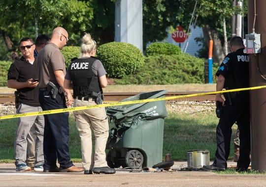 Monroe police investigate an explosive device behind Cloyd's Beauty Schools on Ferrand Street to on Sept. 12 in Monroe, La.