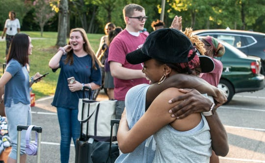 """Four Little Girls"" cast members Trinity Ross and Charles Hunter hug in the parking lot as fellow cast members arrive at Alabama Shakespeare Festival on Wednesday, Sept. 11, 2019."