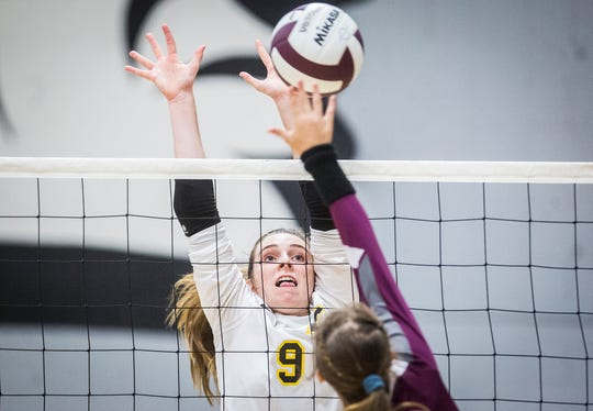 Cowan's Gracie Conway blocks a hit from Wes-Del during their game at Wes-Del High School Wednesday, Sept. 11, 2019.