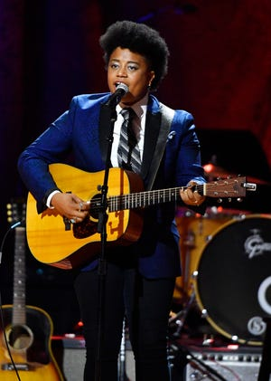 Amythyst Kiah performs with Our Native Daughters at the Americana Music Honors & Awards Wednesday, Sept. 11, 2019 at the Ryman Auditorium in Nashville, Tenn.