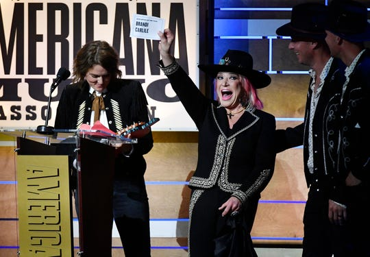 Tanya Tucker holds Brandi Carlile's name as winner of Artist of the Year at the Americana Music Honors & Awards Wednesday, Sept. 11, 2019 at the Ryman Auditorium in Nashville, Tenn.