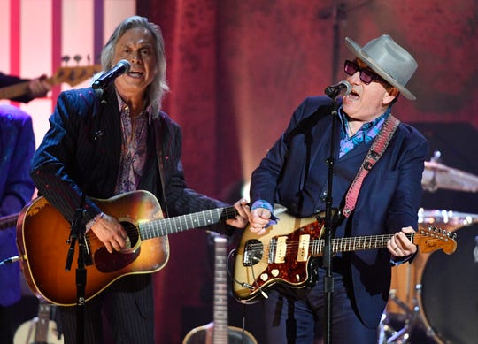 Elvis Costello performs with Jim Lauderdale and The McCrary Sisters at the Americana Music Honors & Awards Wednesday, Sept. 11, 2019 at the Ryman Auditorium in Nashville, Tenn.