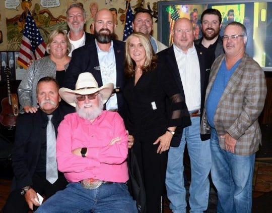 Back row, from left: Darryl Worley, Storme Warren and Chris Young. Middle row: Sarah Morrison (Shepherd Center), Travis Ellis (Shepherd's Men), Judy Seale, Gen. Max Haston (The Journey Home Project) and Donnie Mingus. Front row: David Corlew (The Journey Home Project) and Charlie Daniels.