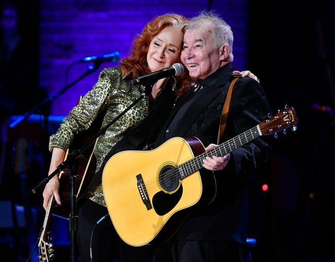 Bonnie Raitt and John Prine embrace after their performance at the Americana Music Honors & Awards on Sept. 11, 2019, at the Ryman Auditorium in Nashville.