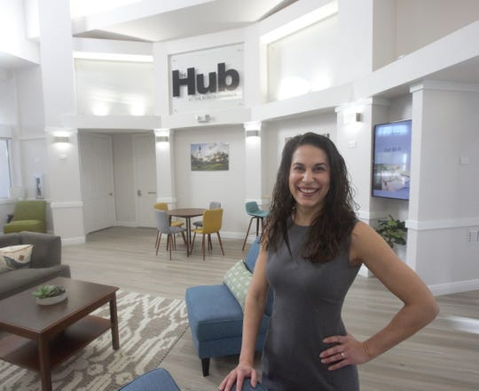 Tiffany Esposito, president and CEO of  the Bonita Springs Area Chamber of Commerce, stands in front of The Hub, a new space for local business leaders to meet and interact.