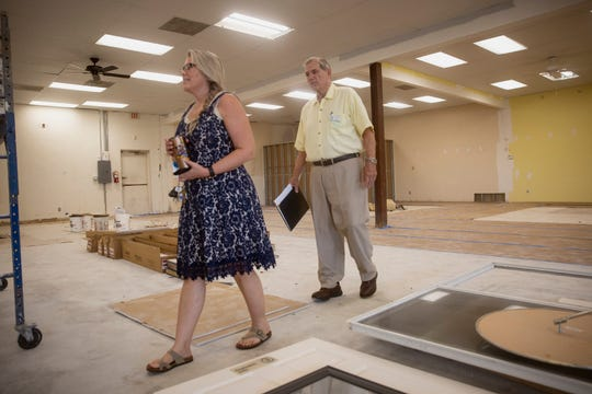 Kim Schul, executive director of SVDP, left, and SVDP Naples District Council President Denis Dugan tour of their new location, Thursday, Sept. 12, 2019, in East Naples.