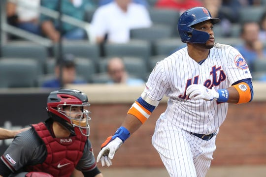 New York Mets' Robinson Cano watches the ball after hitting a solo home run during the fifth inning of a baseball game against the Arizona Diamondbacks, Thursday, Sept. 12, 2019, in New York. (AP Photo/Mary Altaffer)