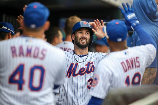 New York Mets' Tomas Nido celebrates hitting a solo home run during the fifth inning of a baseball game against the Arizona Diamondbacks, Thursday, Sept. 12, 2019, in New York. (AP Photo/Mary Altaffer)