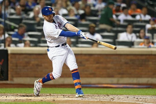J.D. Davis #28 of the New York Mets hits an RBI single to left field in the first inning against the Arizona Diamondbacks at Citi Field on September 11, 2019 in New York.