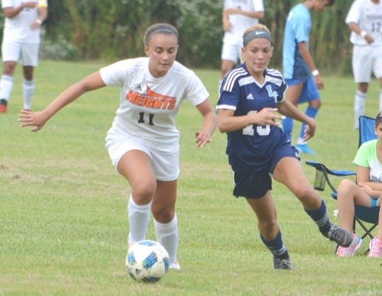 Hasbrouck Heights senior Amanda Gasparino (11) heading down field against Immaculate Conception senior Shea Ramirez.