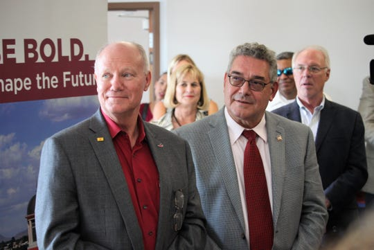 From left, Spaceport America CEO Dan Hicks and New Mexico State University President John Floros at a reception for the spaceport's new office suite on the NMSU campus, Wednesday, September 11, 2019.