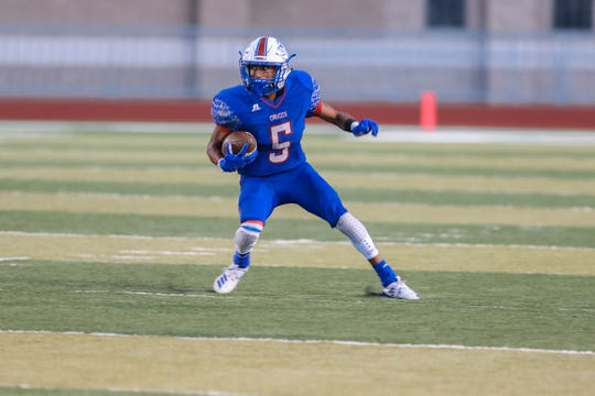Senior running back Johnny Terrazas (5) runs the ball as the Las Cruces Bulldawgs and the La Cueva Bears from Albuquerque face off at the Field of Dreams in Las Cruces on Friday, Sept. 6, 2019.