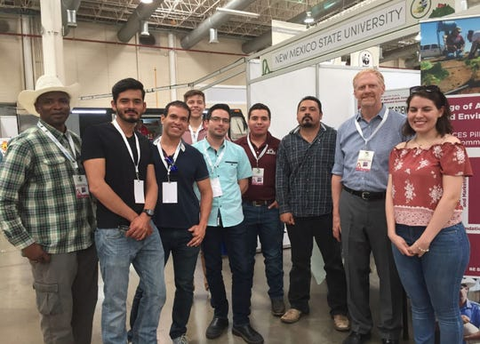 The New Mexico State University College of Agricultural, Consumer and Environmental Sciences representatives worked a booth at the Chihuahua Agro Expo in Chihuahua City, Mexico, and met with prospective students. From left; Soum Sanogo, College of ACES professor; Alonso Garcia and Jorge Fernandez, ACES alumni; Mark Sheely (back row), program coordinator of the Water Resource Research Institute; Jorge Preciado and Joaquin Figueroa, ACES graduate students; a prospective student; Sam Fernald, professor of Watershed Management and director of Water Resources Research Institute; and a second prospective student.