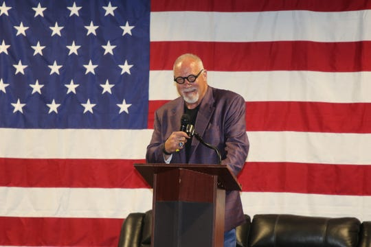 """NFL Hall of Famer Randy """"The Manster"""" White talks during the Carlsbad Mayor's Energy Summit in Carlsbad on Sept. 12, 2019"""