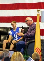 """Carlsbad quarterback Kaden Smith listens to """"The Manster"""" Randy White talk about his playing days for the Dallas Cowboys during the Carlsbad Mayor's Energy Summit in Carlsbad on Sept. 12, 2019"""