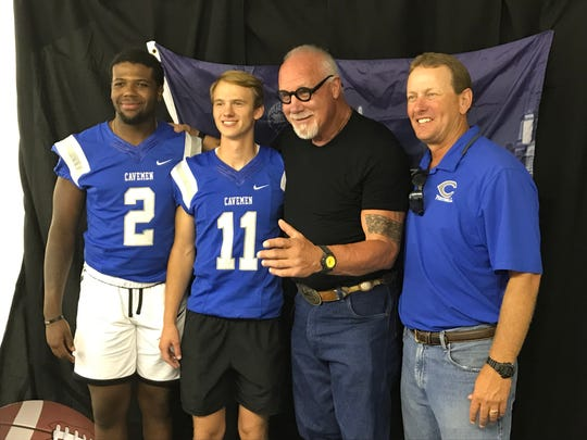 """Left to right: Carlsbad's Shamar Smith, Kaden Smith, Randy """"The Manster"""" White and football coach Gary Bradley pose for a photo during the Carlsbad Mayor's Energy Summit in Carlsbad on Sept. 12, 2019"""