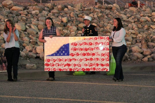 A part of the memorial was returning the hand print flag that students from High Rolls/Mountain Park Elementary gave to then-NYFD firefighter Archie Koenemund in November 2001. Two of the students whose hand prints are on the flag are Heather Wilkey and Mykela Finnegan. Alamogordo remembered the Sept. 11 attacks with a solemn parade and memorial at the New Mexico Museum of Space History  September 11, 2019.