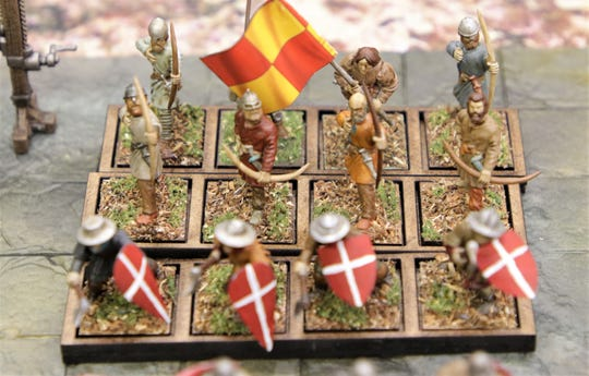 """Hand-painted figures are used in """"Banners and Billhooks."""""""