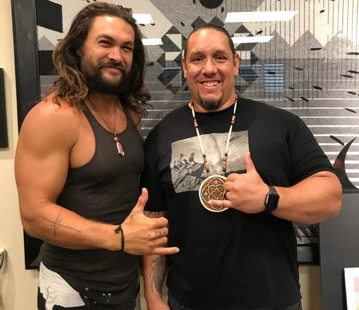 """Actor Jason Momoa (left) is thumbs up with tribal Chairman Jeff Grubbe of the Agua Caliente Band of Cahuilla Indians. The actor, known mainly for his roles as theAquamanand Dothraki chieftain Khal Drogo on """"Game of Thrones,"""" was in the Coachella Valley scoping out sites for an upcoming film."""