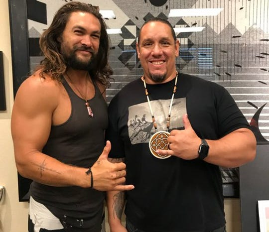 "Actor Jason Momoa (left) is thumbs up with tribal Chairman Jeff Grubbe of the Agua Caliente Band of Cahuilla Indians. The actor, known mainly for his roles as the Aquaman and Dothraki chieftain Khal Drogo on ""Game of Thrones,"" was in the Coachella Valley scoping out sites for an upcoming film."