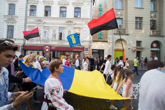 Members of Svoboda, a right-wing Ukrainian political party, march through Kharkiv on Ukrainian Flag Day, a holiday that commemorates when the Ukrainian flag was first hoisted above the nation's parliament after independence from the Soviet Union, on August 23, 2019.