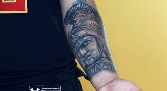 Elijah Sanchez shows off his tattoo of Achilles, the Greek war hero, that he has on his left forearm.