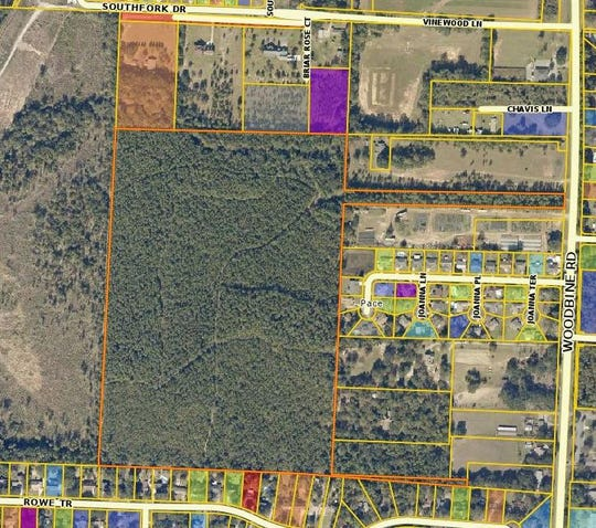 The 63-acre parcel, outlined in Orange, sits adjacent to Woodbine Road in Pace. The school district is looking at purchasing the property for $1.6 million.