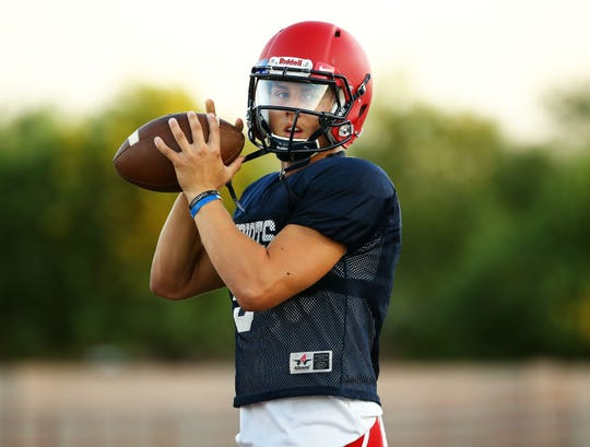 American Leadership Academy Queen Creek quarterback Rand Jensen looks to pass during a practice on Sept. 10.
