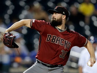 Sep 11, 2019; New York City, NY, USA; Arizona Diamondbacks pitcher Robbie Ray (38) pitches against the New York Mets during the first inning at Citi Field. Mandatory Credit: Adam Hunger-USA TODAY Sports