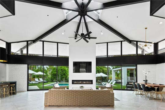 Tedd J. Barr paid $2.83 million for this home in Paradise Valley. The estate features a family room with massive exposed wooden beams and skylights.
