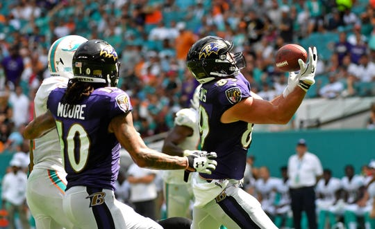 Ravens tight end Mark Andrews (89) hauls in a catch in front of Dolphins cornerback Eric Rowe (21) during the second half of a game Sept. 8 at Hard Rock Stadium.