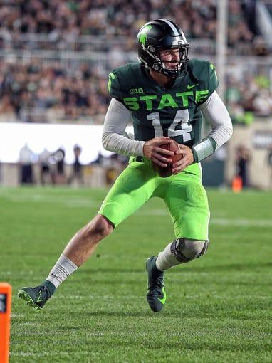 Michigan State Spartans quarterback Brian Lewerke (14) went to Pinnacle High in Phoenix.