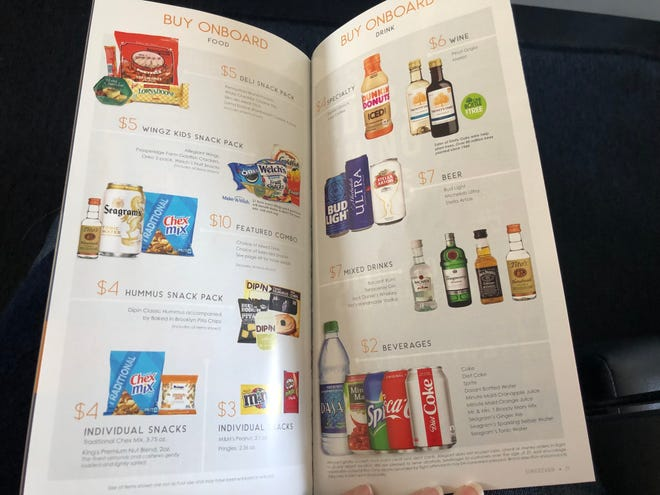 Menu of drinks on an Allegiant flight. A soft drink or bottled water will cost you $2.