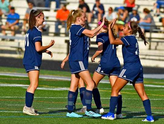 Dallastown celebrates a goal by Annabelle Wunderlich in the second period putting the Wildcats up 3-0 over Spring Grove, Thursday, September 12, 2019.
