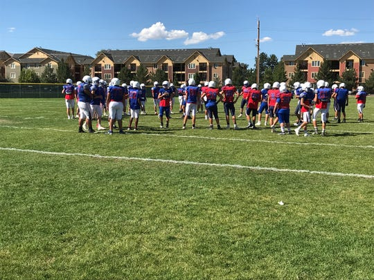 The Reno football team practices last week at the school.