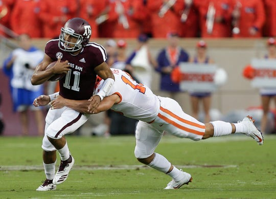 Clemson's Tanner Muse tackles Texas A&M quarterback Kellen Mond during a game last season. Muse and the secondary are one of the most improved units on the Tigers.