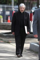 Bishop Salvatore Matano leaving federal court with attorneys for the Roman Catholic Diocese of Rochester after the diocese filed bankruptcy.