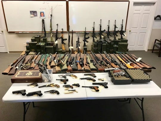 Sixty firearms, including seven assault rifles, and more than 50,000 rounds of ammunition were confiscated from a Red Bluff man this week.