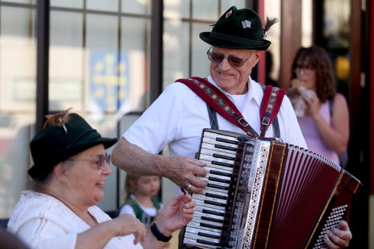 Richard Moles, 82, of Silverton, and a self-described strolling minstrel, plays his accordion during Oktoberfest in Mt. Angel on Sep. 12, 2019. The festival continues through Sunday.